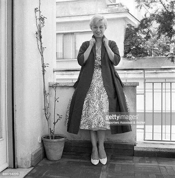 The Italian actress Giulietta Masina posing on her balcony while wearing elegant dresses Rome 1956
