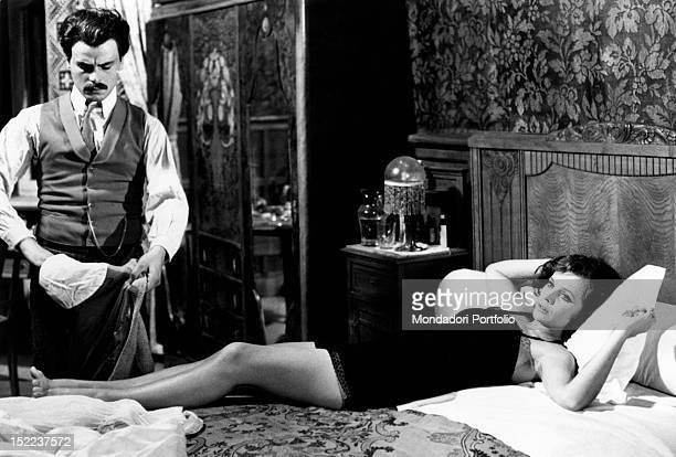 The Italian actress Laura Antonelli and the Italian actor Michele Placido acting in the film 'Till marriage do us part' Rome 1974