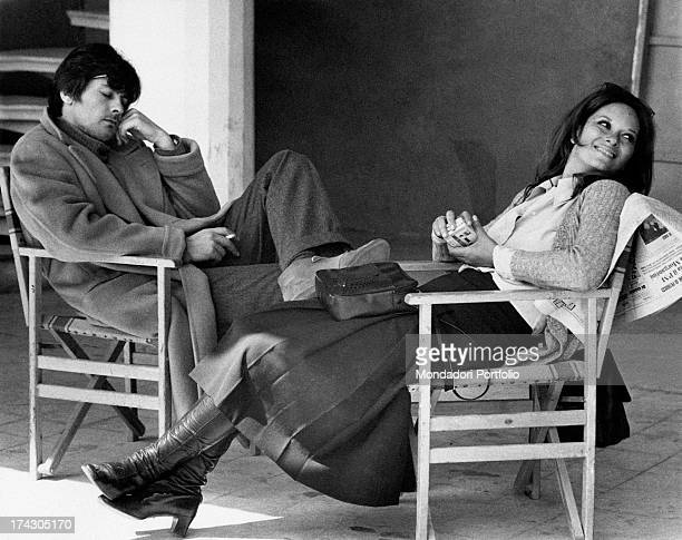 The Italian actress Lea Massari and the French actor Alain Delon during a shooting break of the film La prima notte di quiete directed by Valerio...