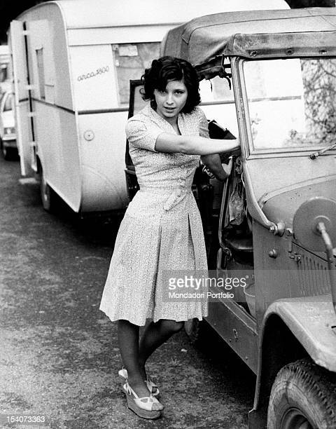 The Italian actress Lina Polito posing leaning on a jeep during a break in the film Salvo D'Acquisto. Rome, 1975