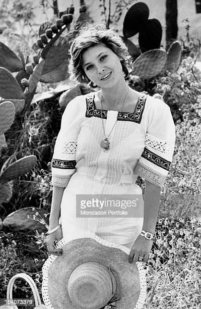 The Italian actress Lina Polito posing with a straw hat in her hand. Taormina, 1970s