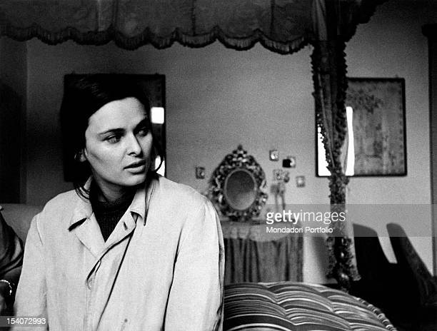 The Italian actress Lucia Bose sitting on a bed in the film Abandoned Ripalta Guerina 1950s