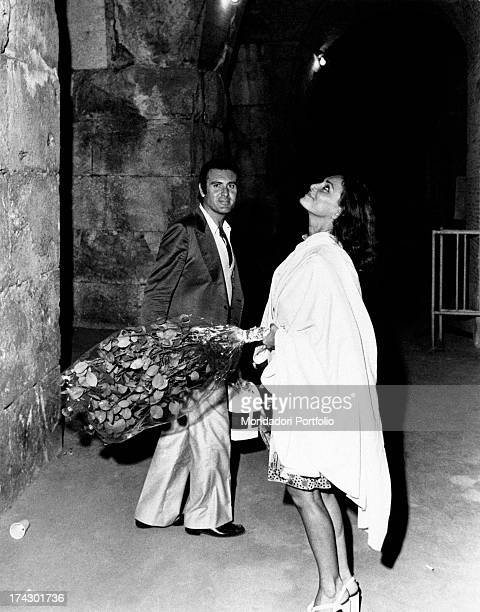 The Italian actress Lydia Alfonsi born Lidia Alfonsi with a bouquet of flowers in hand together with her husband Vincenzo Messina they have just come...