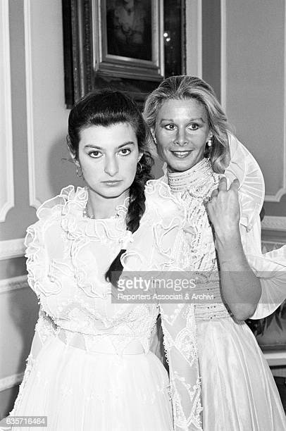 The Italian actress Marisa Allasio trying on wedding dresses in Elvira Gramano's atelier with the daughter Anda Federica Angelica Maria dei Conti...