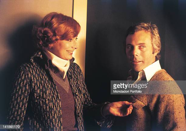 The Italian actress Rossella Falk laughing with Italian designer Giorgio Armani. 1970s