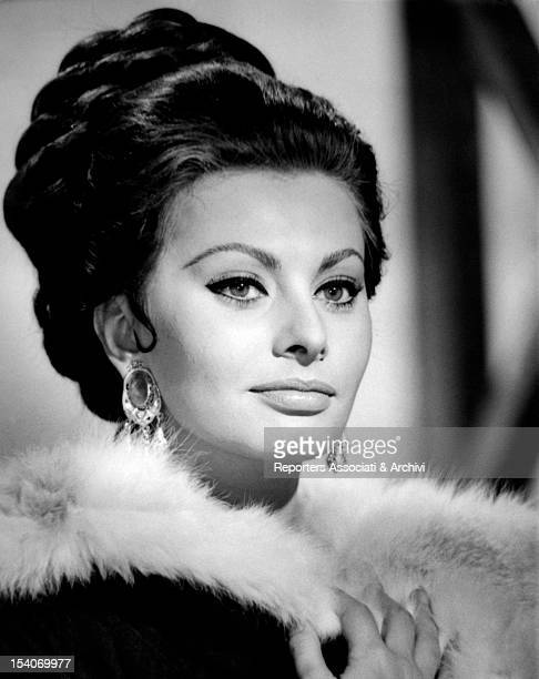 The Italian actress Sophia Loren trying on an hair style fand a scene costume with a fur neck for the film The Fall of the Roman Empire Rome December...
