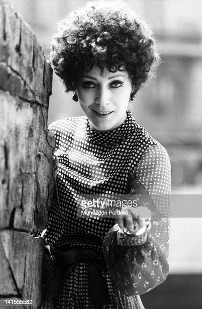 The Italian actress Valentina Cortese smiling and holding out a hand Milan 1969