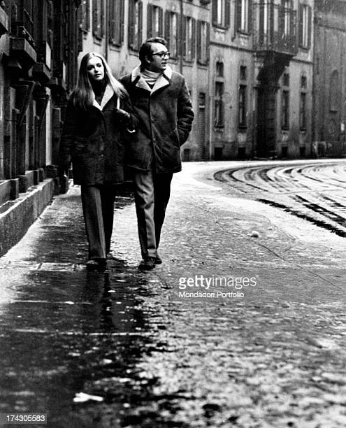 The Italian actress Valeria Ciangottini is walking along the snowcovered streets of Milan with her boyfriend the journalist Fabrizio Ricci the...