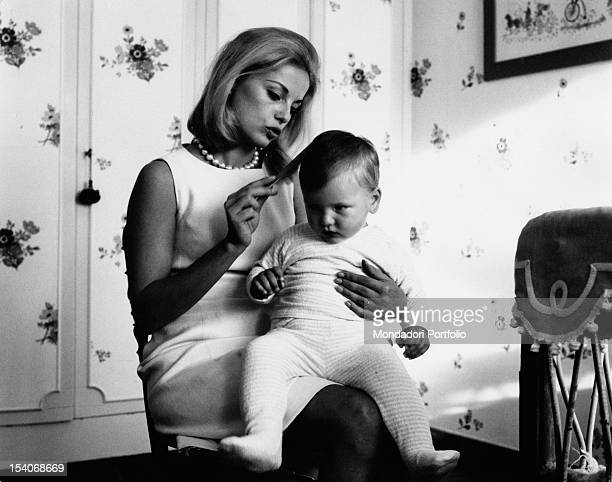 The Italian actress Virna Lisi combing her son Corrado Pesci at Villa Le Selve 1963