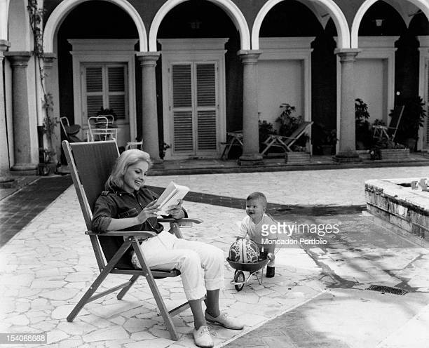 The Italian actress Virna Lisi having fun her son Corrado Pesci in Villa Le Selve courtyard Marino1963