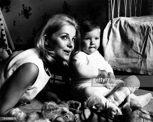 The Italian actress Virna Lisi posing with her son Corrado Pesci 1960s