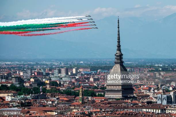"The Italian Air Force acrobatic unit Frecce Tricolori perform on May 25, 2020 over Turin as part of the Aeronautic military initiative ""Abbraccio..."