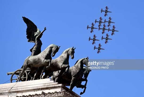 The Italian Air Force acrobatic unit Frecce Tricolori performs over the Altare della Patria - King Vittorio Emanuele II monument, in Rome on March...