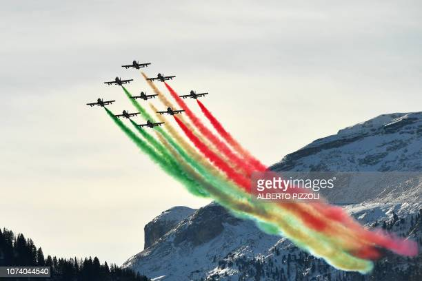 The Italian Air Force aerobatic unit Frecce Tricolori performs during the FIS Alpine World Cup Men Giant Slalom on December 16 2018 in Alta Badia...