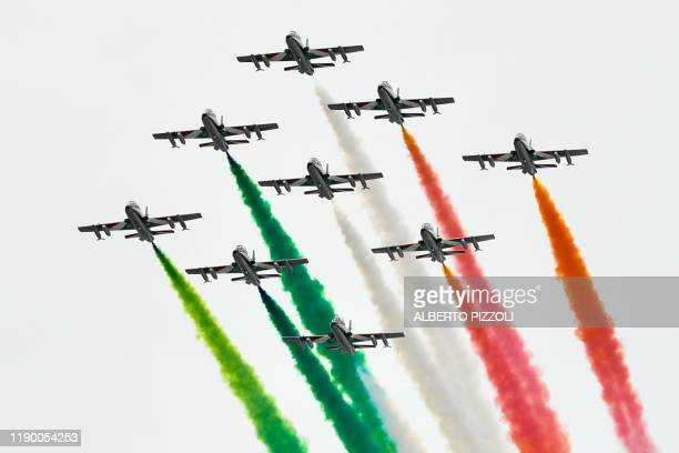 The Italian Air Force aerobatic unit Frecce Tricolori performs within the Men's Giant Slalom of the FIS Alpine World Cup on December 22 2019 in Alta...