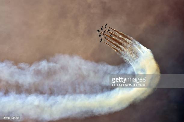 TOPSHOT The Italian Air Force aerobatic unit Frecce Tricolori prepare to spread smoke with the colors of the Italian flag prior the Moto GP Grand...