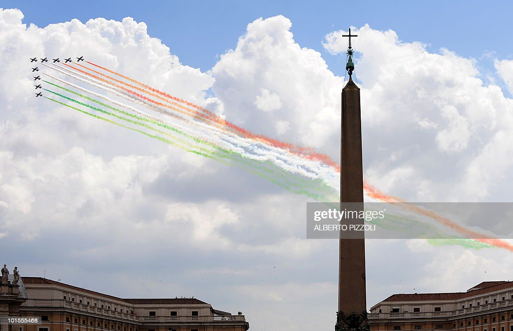 The Italian Air Force aerobatic unit Frecce Tricolori (Tricolor Arrows) spread green, white and red smoke to recall the colours of the Italian flag over St. Peters's square during Pope Benedict XVI weekly general audience at the Vatican on June 2, 2010. Italy celebrates the 64th anniversary of Republic Day.