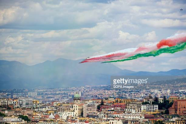 The Italian Air Force aerobatic unit, Frecce Tricolori spread smoke with the colours of the Italian flag over the Gulf of Naples during the ceremony...
