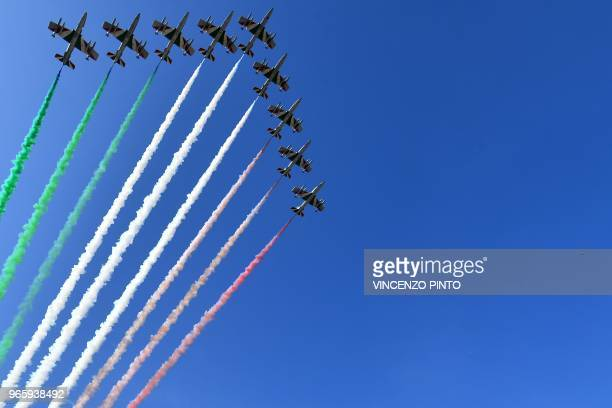 The Italian Air Force aerobatic unit Frecce Tricolori spread smoke with the colors of the Italian flag during the ceremony to mark the anniversary of...