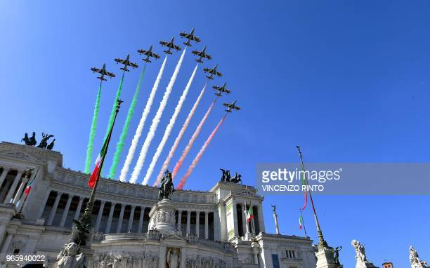 The Italian Air Force aerobatic unit Frecce Tricolori spread smoke with the colors of the Italian flag over the Vittoriano Monument during the...