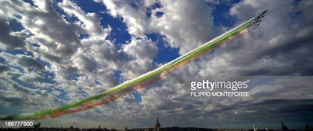 The Italian Air Force aerobatic unit Frecce Tricolori spreads green white and red smoke in the colours of the Italian flag marking the day of...