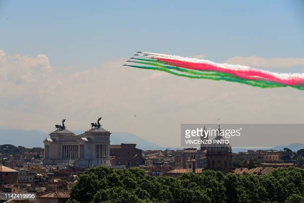 TOPSHOT The Italian Air Force aerobatic unit Frecce Tricolori spreads smoke with the colors of the Italian flag over the city of Rome on June 2 2019...