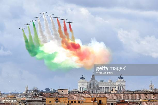 The Italian Air Force aerobatic unit Frecce Tricolori spreads smoke with the colors of the Italian flag over the city of Rome on June 2, 2016 as part...