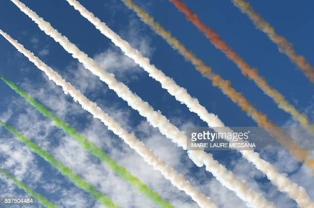 TOPSHOT The Italian Air Force aerobatic unit Frecce Tricolori spreads smoke with the colors of the Italian flag over the Piazza Venezia in Rome on...