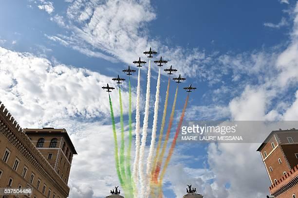The Italian Air Force aerobatic unit Frecce Tricolori spreads smoke with the colors of the Italian flag over the Piazza Venezia in Rome on June 2...
