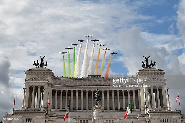 The Italian Air Force aerobatic unit Frecce Tricolori spreads smoke with the colors of the Italian flag over the Piazza Venezia in Rome on June 2...
