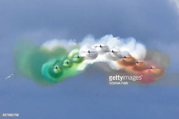 TOPSHOT The Italian Air Force aerobatic unit Frecce Tricolori spreads smoke with the colors of the Italian flag over the city of Rome on June 2 2016...