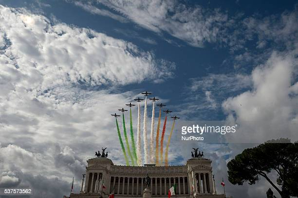 The Italian Air Force aerobatic unit Frecce Tricolori spreads smoke with the colors of the Italian flag over the Piazza Venezia in Rome Italy on June...