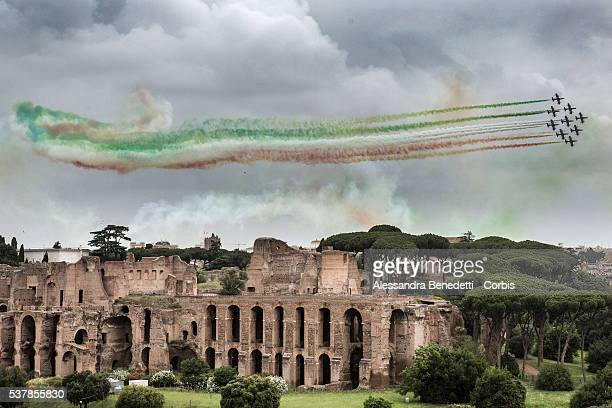 The Italian Air Force aerobatic unit Frecce Tricolori spreads smoke with the colors of the Italian flag over Rome's ancient Palatino Hill as part of...