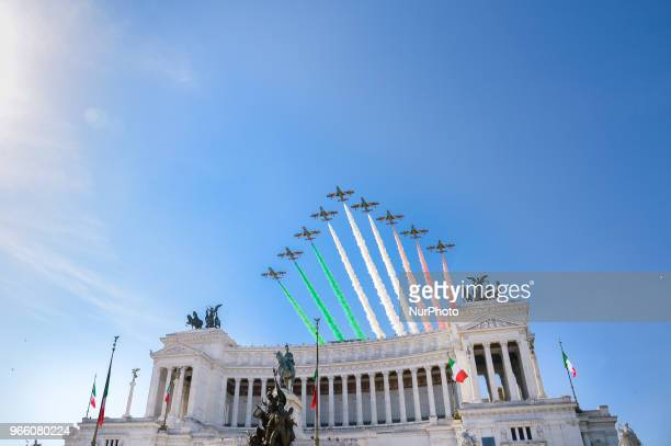 The Italian Air Force aerobatic unit Frecce Tricolori spreads smoke with the colors of the Italian flag over the Vittoriano Monument, on June 2, 2018...