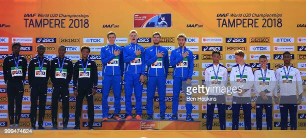 The Italian American and British teams celebrate with their medals during the medal ceremony for the men's 4x400m relay on day six of The IAAF World...