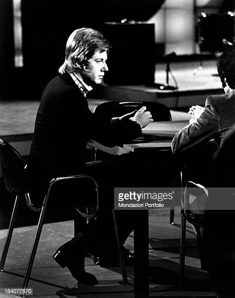 The Italian anchorman and singer Claudio Lippi playing cards in an episode of the TV variety show Tanto piacere Rome 1974