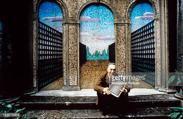 The Italian architect Achille Castiglioni pose seated in the courtyard of the Faculty of Architecture in Milan Milan 1983