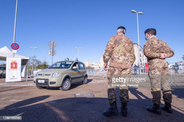 "The Italian Army look on at a drive-in Covid-19 test centre, part of Operation ""IGEA"" commissioned by Defense Minister Lorenzo Guerini during the..."
