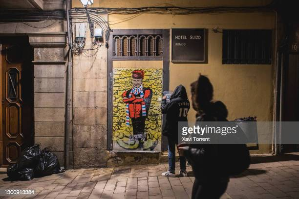 The italian artist TVboy installs his new work 'Despicable Me 4' featuring Vladimir Putin on February 07, 2021 in Barcelona, Spain. The Russian...