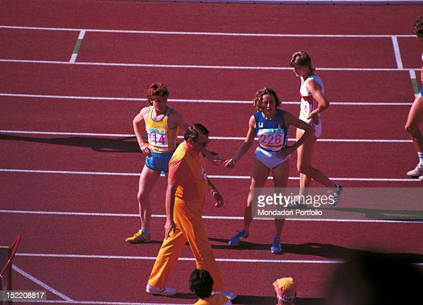 The Italian athlete Gabriella Dorio and Romanian athlete Fita Lovin having a rest on the track after a race at Los Angeles Olympics Los Angeles 1984