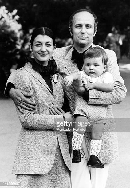The Italian ballerina Carla Fracci posing with her husband Beppe Menegatti and her son Francesco in Milan 1970s