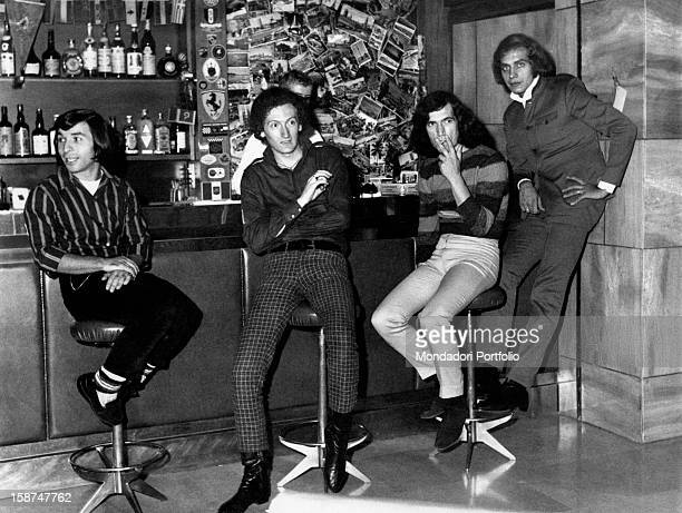 The Italian band Equipe 84 sitting on the stools at the bar Italy 1968