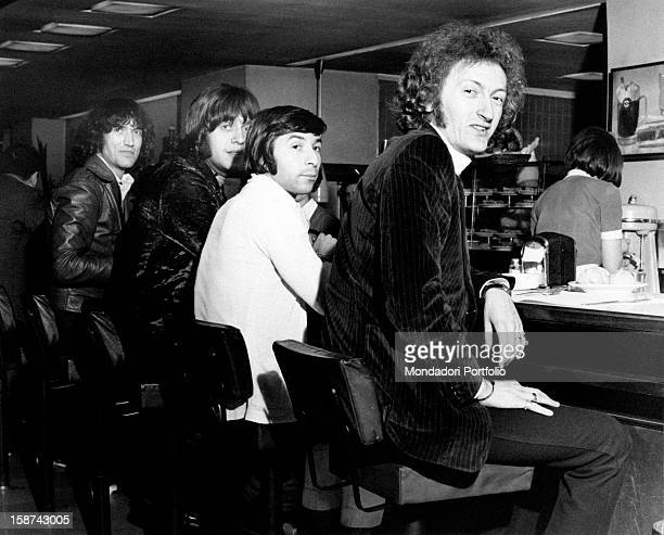 The Italian band Equipe 84 sitting on the stools at the bar Milan May 1968