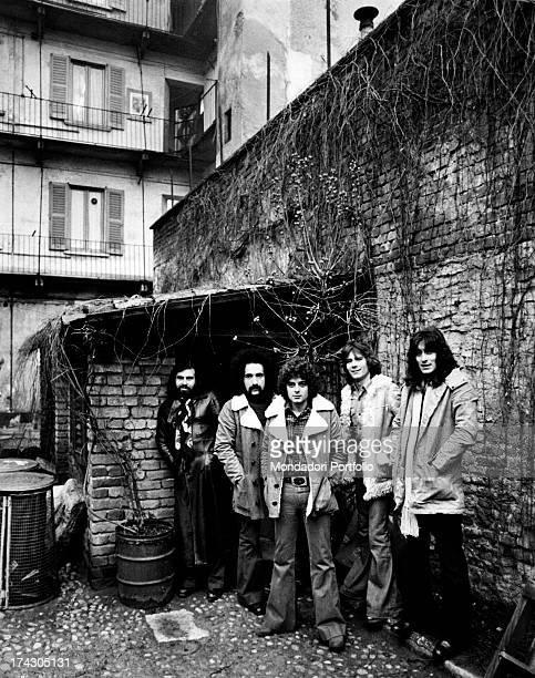 The Italian band I Camaleonti next to a brick wall completely ivycovered from the left Paolo de Ceglie Livio Macchia Antonio Cripezzi known as Tonino...