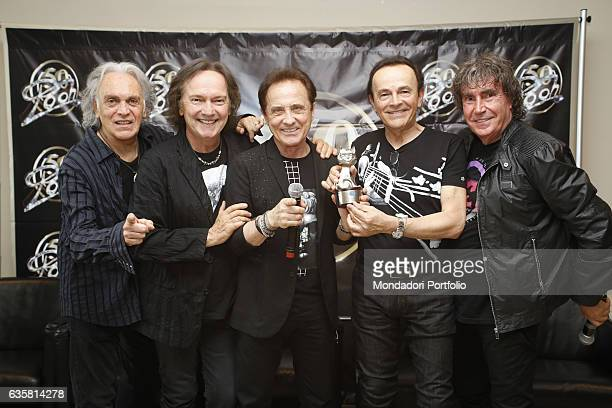 The Italian band Pooh posing with the platinum Telegatto Anniversary Special awarded by the director of Sorrisi Aldo Vitali to celebrate the band's...
