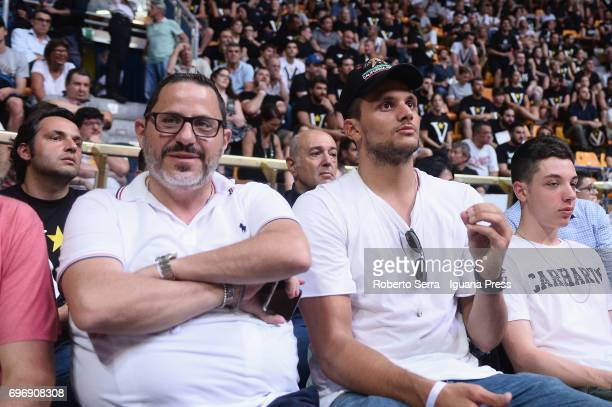The italian basketball players agent Riccardo Sbezzi and the player Alessandro Gentile attends the match game 1 of play off's final series of italian...