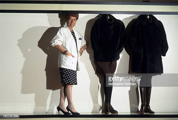 The Italian business woman Carla Fendi standing near some models made by her fashion house 1987