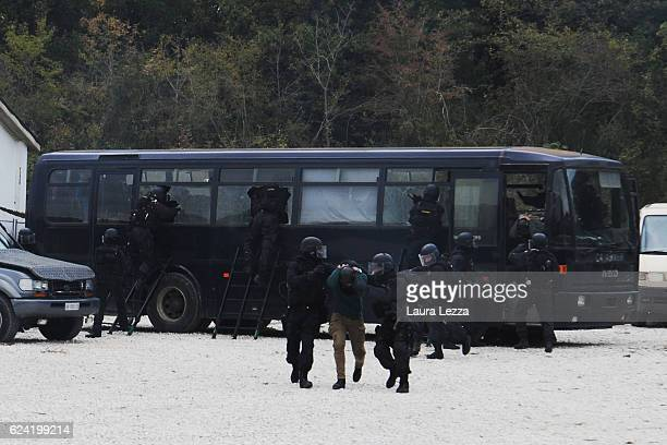 The Italian Carabinieri military police GIS simulate an intervention during an antiterrorism training with the first dog of the Dog Unit of the GIS...