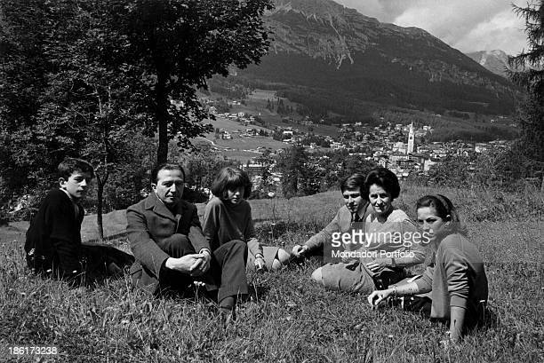 The Italian Christian Democrat politician Giulio Andreotti sat in a meadow with his wife Livia Danese and their children Marilena Lamberto Stefano...
