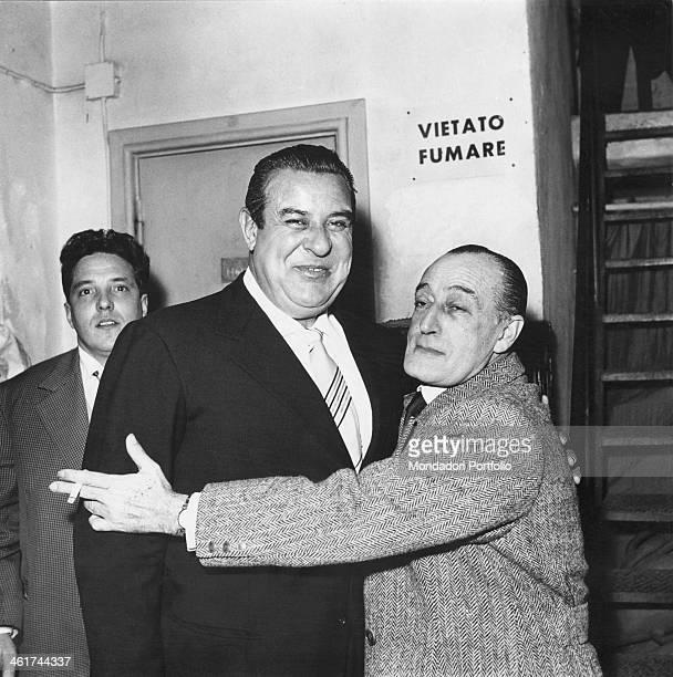 The Italian comedian Totò born Antonio De Curtis and nicknamed il principe della risata is lovingly embracing Alberto Rabagliati singer radio star of...